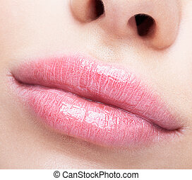 Closeup shot of plump female lips - Closeup shot of female...