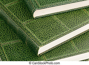 hardcover books - close up of hardcover books with green...
