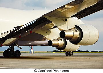 Engines of the cargo airplane - Cargo airplane is taxiing to...