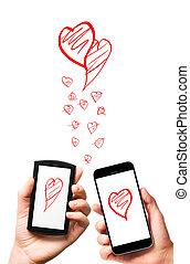 modern smartphones in hands - modern smartphones with hearts...