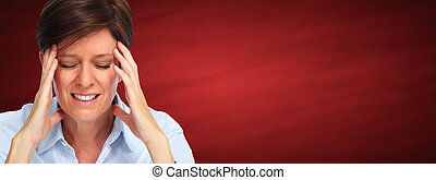 Woman having a migraine headache - Tired business woman with...