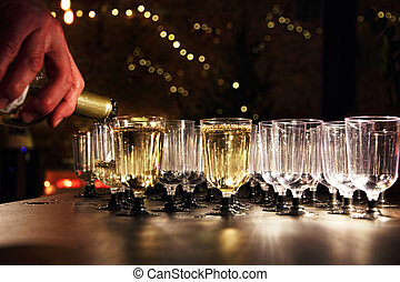 Waiter pour wine in the glass on holiday reception table -...