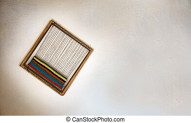 Loom on white wall - Loom as a souvenir on white wall,...
