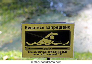The sign prohibiting swimming - Swimming is prohibited...
