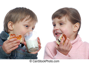 children having lunch with milk - two 5 year old kids eating...