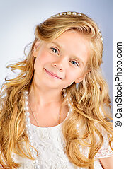 blonde hair - Portrait of a pretty little girl with...