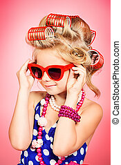 pin-up glasses - Fashionable little girl in her mother's...