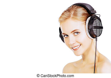 soothing music - Smiling girl in headphones Isolated over...