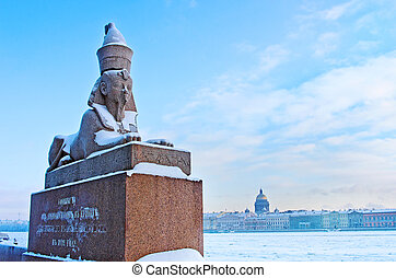 Authentic antique Egyptian sphynx on quay of the Neva river...