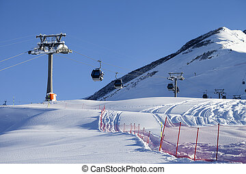 Gondola lift on ski resort at sun day Greater Caucasus,...