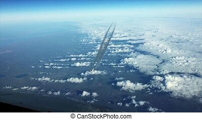 Airplain contrail going through the cloudness sky - Airplain...