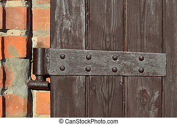 Antique door hinge - Old door hinge on wooden door closeup