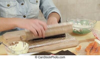 twisting roll sushi salmon nori