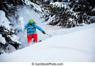 Man freerideer running downhill in forest - Action photo of...
