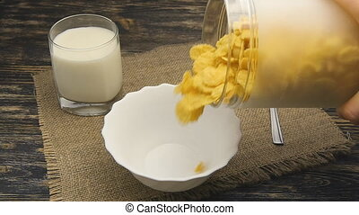Cornflakes pouring into bowl in slow motion - Cereal pouring...