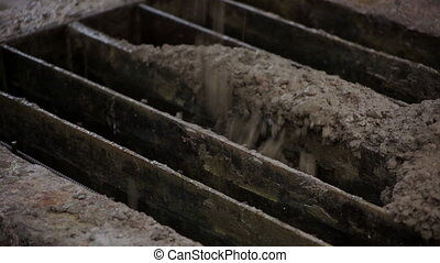 Concrete is spreading over reinforcing steel bars - Concrete...