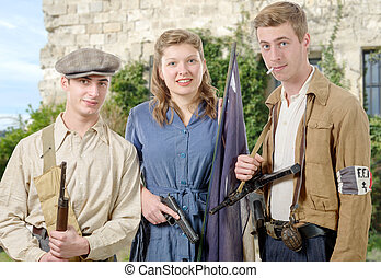 three young French Resistance, vintage clothes and weapons,...