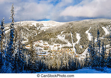 Skiing above village of Sun Peaks - The village of Sun Peaks...