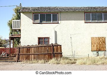 Run-down House - A run-down residential building on the edge...