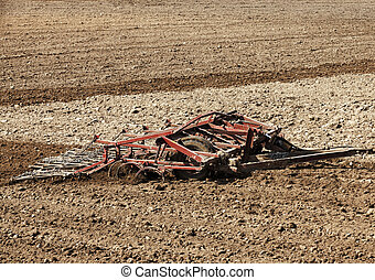 tractor in the field - the agricultural field, which plowed...