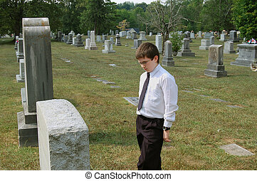 Young One Mourns his Loss - Young man mourns the loss of a...