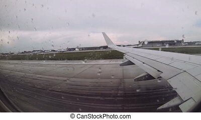 view from the airplane - Takeoff in rainy weather....