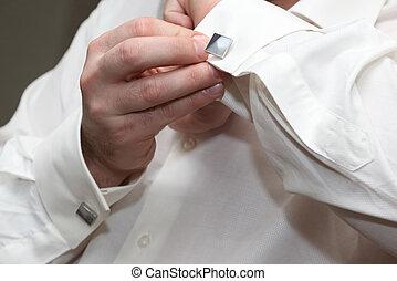 the man wears a cufflink