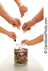 Hands of different generations saving coins - Hands of...