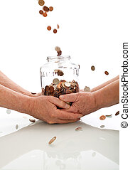 Elderly hands holding jar catching falling coins -...