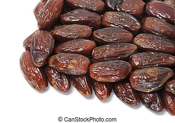 dates - a pile of dates isolated on a white background