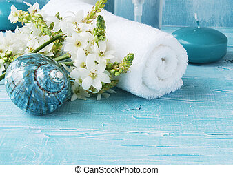 White flowers lying on and candle Spa set - White flowers...