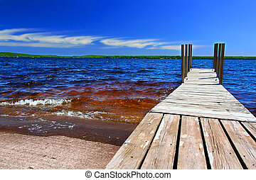 Lake Gogebic Landscape - Wooden dock and choppy waters of...