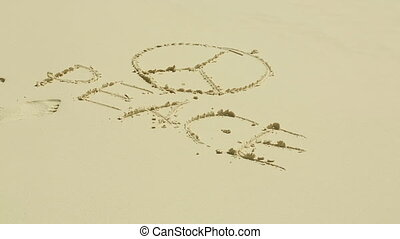 Peace sign on sand - Peace symbol on the sand beach on a...