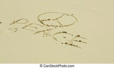 Peace sign on sand - Peace symbol on the sand beach on a...