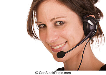 Young friendly brunette woman with headset smiling during...