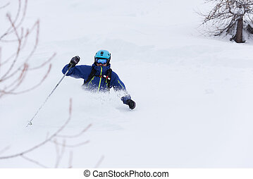 freeride skier skiing in deep powder snow - extreme freeride...
