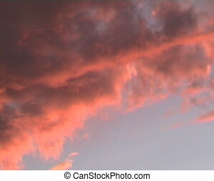 red float cloud on sky at sunset