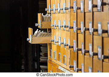 wooden card catalog in the archive - Old wooden card catalog...