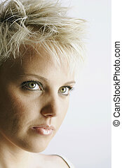 Attractive Young Woman With Short Blond Hair - Portrait of...
