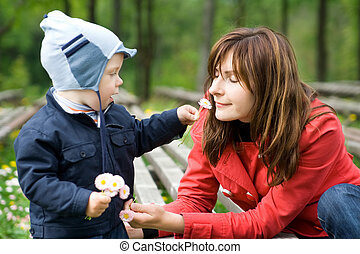 Mother and Son in the park - Spring day in the park. Mother...