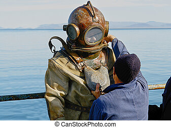 Diver in heavy spacesuit - Diver in heavy spacesuit plunges...