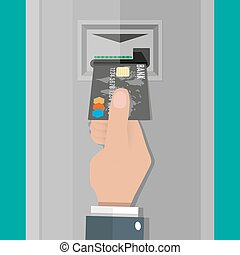 Hand inserts a credit  debit card into ATM