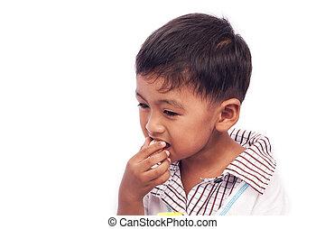 little boy eating snack food