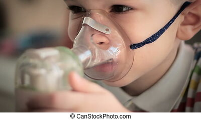 Child with inhaler 1 - The little boy makes treatment...