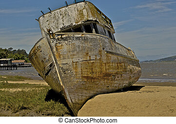 A circa 1930 Fishing Boat lies abandoned and alone on a...