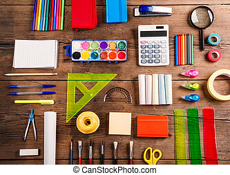 Back to school composition - Desk with stationary. Studio...