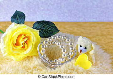 Yellow rose with ribbon