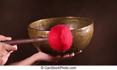 Singing bowl with sound - Tibetan singing bowl being made to...