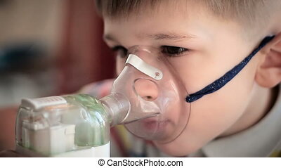 Child with inhaler 5 - The little boy makes treatment...