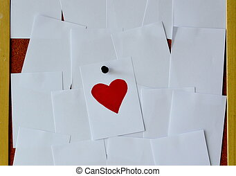 red heart paper note on noticeboard